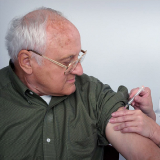 Getting a Flu Vaccination for older people who are advised to shield.