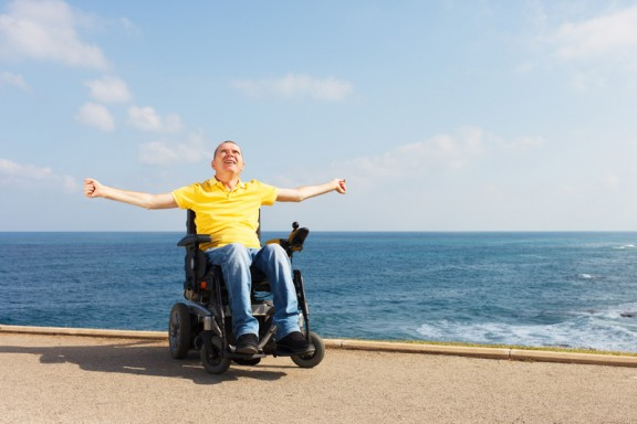 Disabled man on holiday with his holiday companion