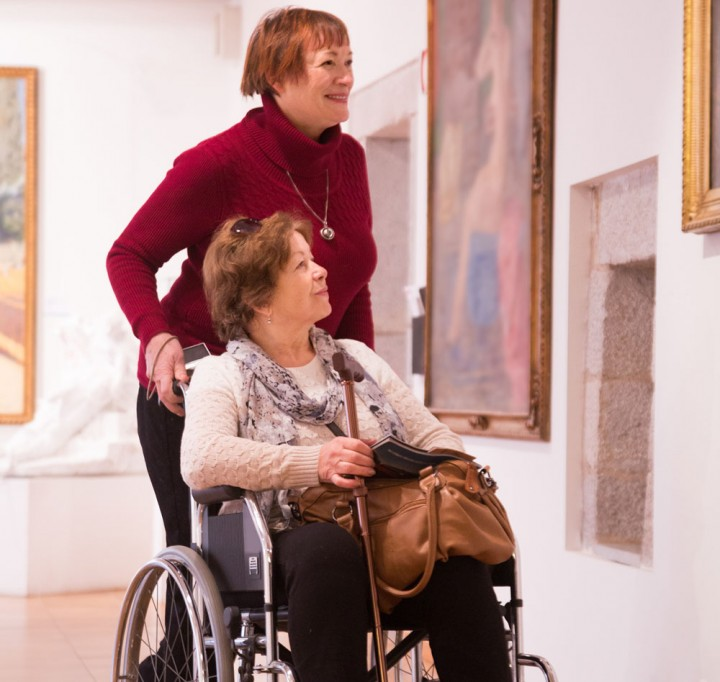 Disabled lady in art gallery